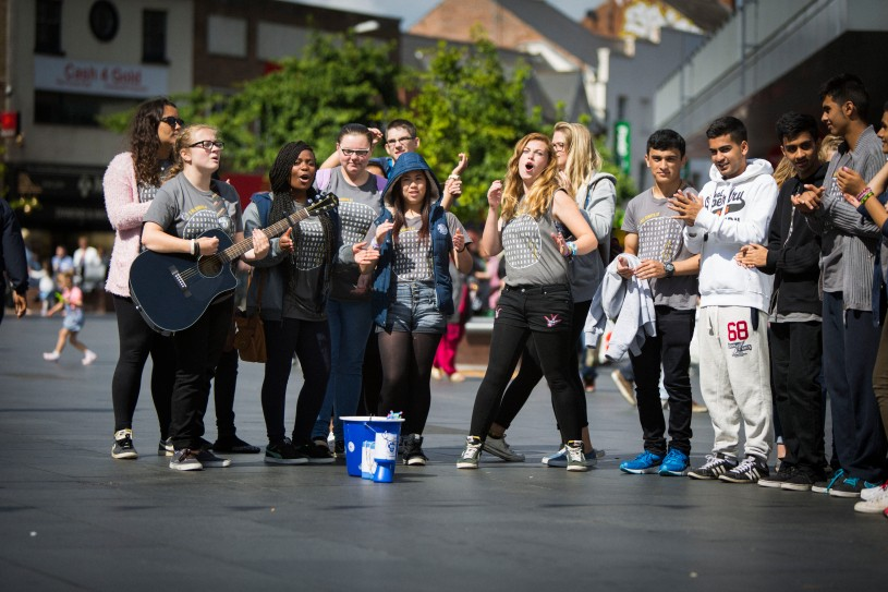 Social-action-singing-in-town-centre-220914